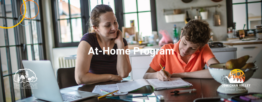 A student and parent doing homework at the dinner talbe. At-Home Program superimposed over top
